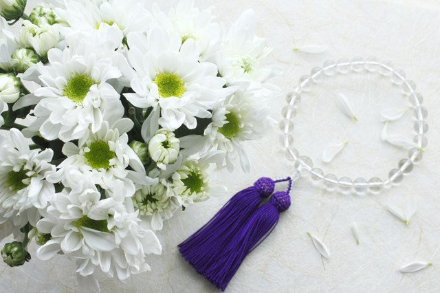 Chrysanthemum bouquet and rosary